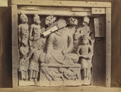 Buddhist sculpture slab from Mir Jan, Peshawar District: Mara's attack on the Buddha.